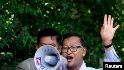 Sam Rainsy, president of the National Rescue Party, addresses his supporters at the CNRP office in Phnom Penh, August 16, 2013.