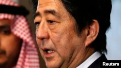 Japan's Prime Minister Shinzo Abe speaks to reporters after signing a condolences book as he pays his respect for Saudi Arabia's King Abdullah, during a visit to the Royal Embassy of the Saudi Arabia in Tokyo, Jan. 25, 2015.