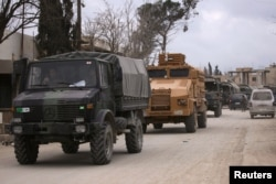 Turkish military vehicles drive in the Syrian rebel-held town of al-Rai, as they head towards the northern Syrian town of al-Bab, Syria, March 2, 2017.