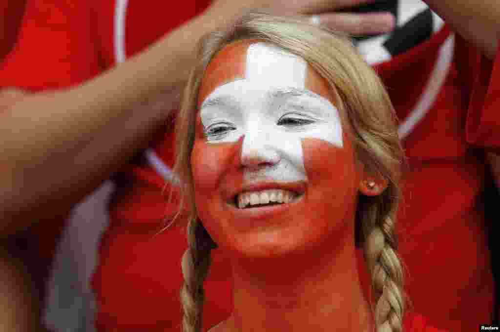 A Switzerland fan smiles while attending their men's Group B football match against South Korea in the London 2012 Olympic Games at the City of Coventry stadium July 29, 2012.