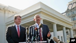 Goldman Sachs Group, Inc., Chairman and CEO Lloyd Blankfein, right, accompanied by Bank of America CEO Brian Moynihan, speaks to reporters outside the White House in Washington, Wednesday, Oct. 2, 2013.
