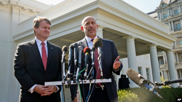 Goldman Sachs Group, Inc., Chairman and CEO Lloyd Blankfein, right, accompanied by Bank of America CEO Brian Moynihan, speaks to reporters outside the White House in Washington on Oct. 2, 2013, after they and other financial leaders met with President Barack Obama regarding the debt ceiling and the economy.
