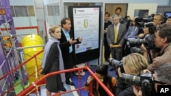 France's Ecology, Transport and Housing Minister Nathalie Kosciusko-Morizet (L) visits the French Alternative Energies and Atomic Energy Commission CEA in Gif-sur-Yvette near Paris, June 7, 2011