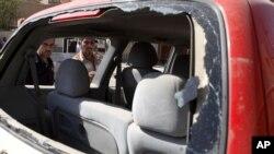 Hiện trường sau vụ đánh bom xe tại Baghdad, ngày 30/9/2012