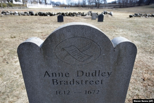 This Tuesday, March 19, 2019, photo, shows a commemorative marker for 17th century American poet Anne Bradstreet at an old burial ground, in North Andover, Massachusetts.
