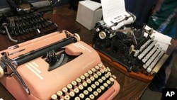 "Vintage typewriters are on display at a ""type-in"" in Albuquerque, N.M., April 23, 2017. ""Type-ins"" are social gatherings in public places where typewriter fans test different vintage machines."