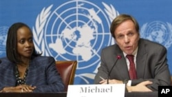 United States' Michael Posner, right, Assistant Secretary of State for Democracy Human Rights and Labor, and United States' Esther Brimmer, left, Assistant Secretary of State for International Organizations Affairs, attend a press conference after the Un