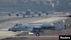 FILE - A U.S. Air Force A-10 Thunderbolt II fighter jet lands at Incirlik airbase in the southern city of Adana, Turkey, Dec. 10, 2015. The U.S. uses the base to launch attacks into Syria.