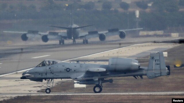 FILE - A U.S. Air Force A-10 Thunderbolt II fighter jet lands at Incirlik airbase in the southern city of Adana, Turkey, Dec. 10, 2015.