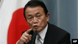 日本副首相麻生太郎12月26日在东京