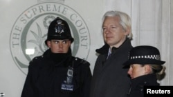 Julian Assange walked by two bobbies in to Supreme Court in London
