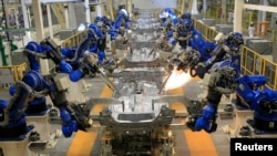 FILE - A production line is seen after the opening of Honda's new automobile plant in a suburb of Celaya, Guanajuato, Mexico.