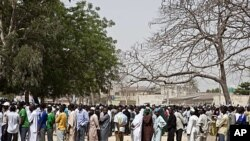 Voters queue to register during parliamentary elections in Kano, northern Nigeria, April 1, 2011