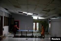 Patients play ping-pong at the rehabilitation and detox area at Wat Thamkrabok monastery in Saraburi province, Thailand, Feb. 8, 2017.