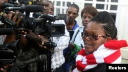 Zimbabwe's Lawyers For Human Rights (ZLHR) Board Member Beatrice Mtetwa speaks to the media outside the High Court after she was granted a $500 bail in Harare, March 25, 2013. (File Photo)