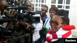 FILE - Zimbabwe's Lawyers For Human Rights (ZLHR) Board Member Beatrice Mtetwa speaks to the media outside the High Court after she was granted a $500 bail in Harare, March 25, 2013.