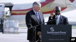 FILE - Liberian Ambassador to the U.S. Jeremiah Sulunteh addresses a news conference at Charlotte Douglas International Airport in Charlotte, North Carolina.