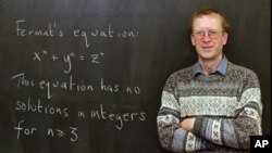 "FILE - Princeton University mathematics professor Andrew John Wiles poses next to ""Fermat's Last Theorem"" written on a chalkboard in his Princeton, N.J., office Tuesday, Jan. 6, 1998."