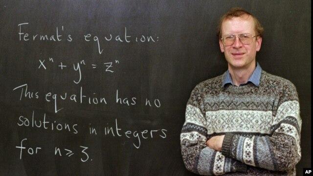 "FILE - Princeton University mathematics professor Andrew John Wiles poses next to ""Fermat's Last Theorem"" written on a chalkboard in his Princeton, N.J., office Tuesday, Jan. 6, 1998."