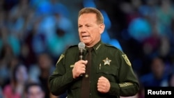 FILE - Broward County Sheriff Scott Israel speaks before the start of a CNN town hall meeting in Sunrise, Florida, Feb. 21, 2018.