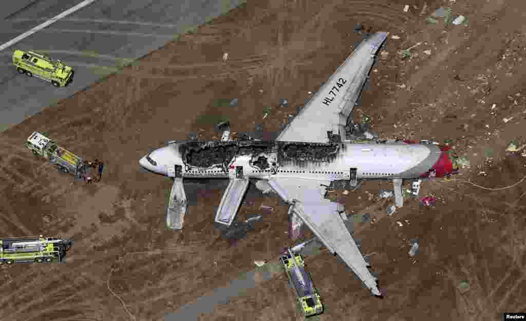An Asiana Airlines Boeing 777 plane is seen after it crashed while landing at San Francisco International Airport in California, July 6, 2013. Two people were killed and 130 were hospitalized.