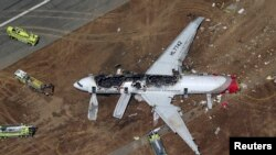 An Asiana Airlines Boeing 777 plane is seen in this aerial image after it crashed while landing at San Francisco International Airport in California on July 6, 2013.