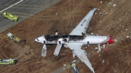 An Asiana Airlines Boeing 777 plane is seen in this aerial image after it crashed while landing at San Francisco International Airport, July 6, 2013.