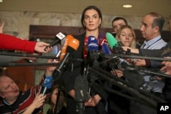 Former Russian pole vaulter Yelena Isinbayeva speaks to the media in Moscow, Russia, Dec. 9, 2016.