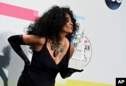Diana Ross poses in the press room with the lifetime achievement award at the American Music Awards at the Microsoft Theater on Sunday, Nov. 19, 2017, in Los Angeles.