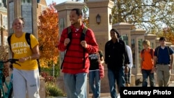 Students walk outside at Michigan State University, one of 11 member institutions of the University Innovation Alliance.