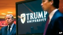 FILE - Donald Trump appears at the 2005 unveiling of the now-defunct Trump University. Lawyers in a class-action lawsuit alleging fraud have agreed to enter settlement talks.