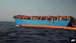 Migrants are crowded on to the vessel in the Mediterranean Sea off the coast of Libya in this Tuesday Oct. 4, 2016 image taken from video.