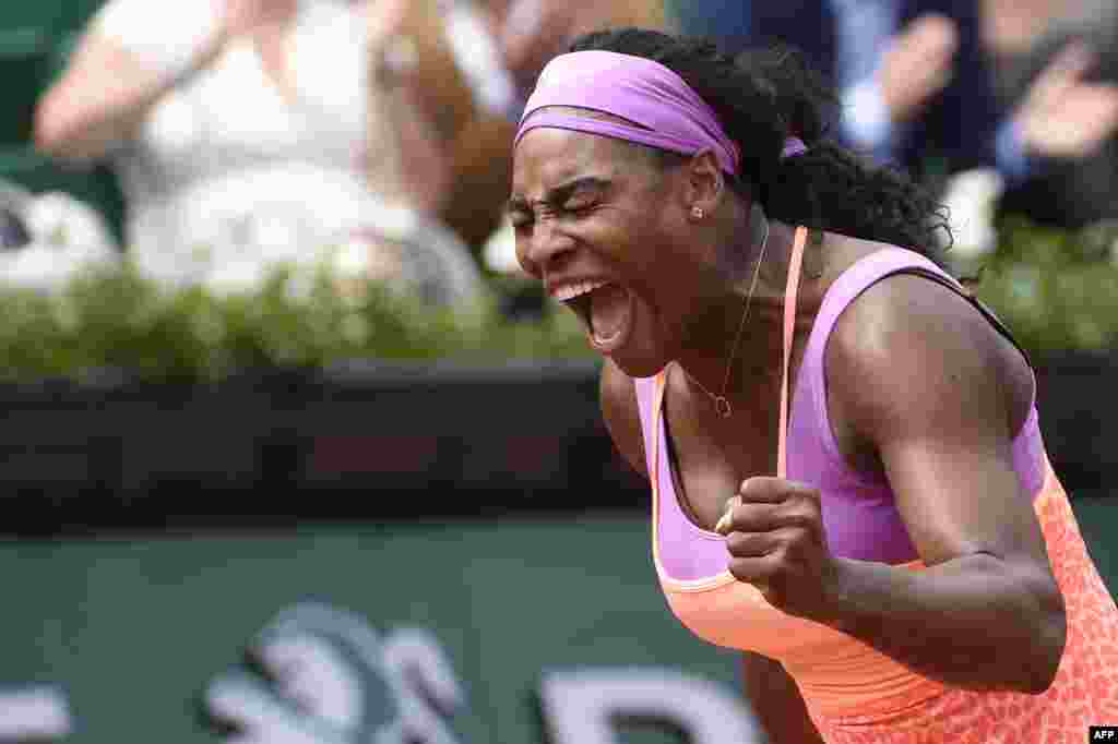 U.S. player Serena Williams celebrates after winning her match against Germany's Anna-Lena Friedsam during the women's second round of the Roland Garros 2015 French Tennis Open in Paris. Williams won the match 5-7, 6-3, 6-3.