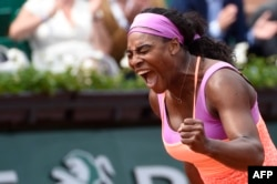 FILE - Serena Williams celebrates after winning her match against Germany's Anna-Lena Friedsam during the women's second round of the Roland Garros 2015 French Tennis Open in Paris on May 28, 2015.