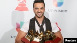 "Luis Fonsi holds his awards for Song of the Year, Record of the Year and Best Long Form Music Video for ""Despacito"" and Best Urban Fusion/Performance for ""Despacito (Remix)."""