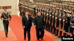 Привітання Кім Чен Ина в Пекіні