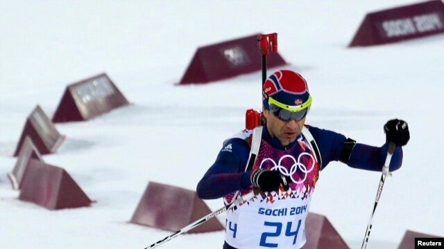 FILE - Norway's Ole Einar Bjoerndalen skis during the men's biathlon 10 km sprint event at the Sochi 2014 Winter Olympics in Rosa Khutor, Feb. 8, 2014.