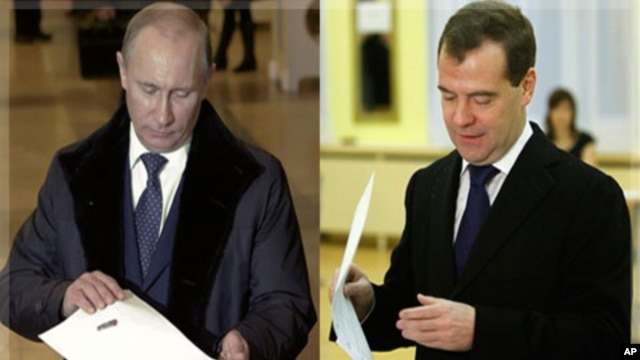 Russian Prime Minister Vladimir Putin, and Russian President Dmitry Medvedev cast their ballots in Moscow, December 4, 2011.