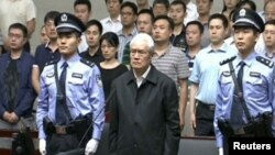 Zhou Yongkang, China's former domestic security chief, listens to his sentence in a court in Tianjin. This still image is taken from video provided by China Central Television and shot on June 11, 2015.