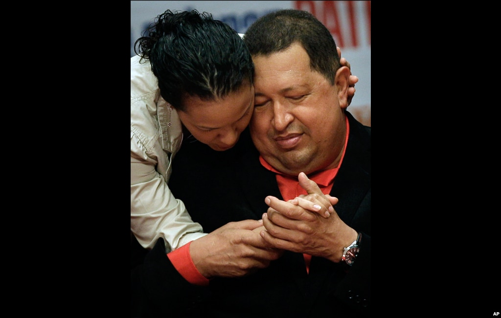 Chavez shares a moment with his daughter Rosa as he attends a concert in his honor at the Teresa Carreno theater in Caracas, February 23, 2012.