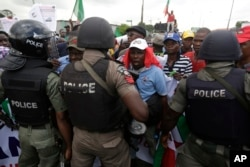 FILE - Protesters face off with policemen following the removal of a fuel subsidy by the government in Lagos, Nigeria, May 18, 2016.