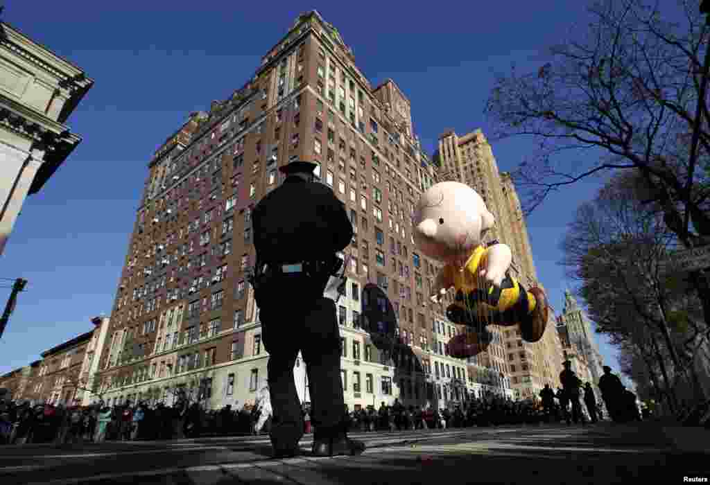 The Charlie Brown balloon floats down Central Park West during the 86th Macy's Thanksgiving Day Parade in New York, November 22, 2012.