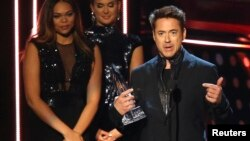 "Robert Downey Jr. accepts the award for favorite action star, and also for favorite action movie and favorite movie for ""Iron Man 3,"" at the 2014 People's Choice Awards in Los Angeles, California, January 8, 2014."