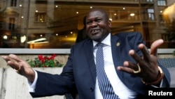 South Sudan's ex-vice president and former rebel leader Riek Machar gestures during an interview with Reuters in Rome, Italy, April 12, 2019