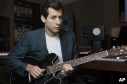 Mark Ronson poses for a photo at Jeff Bhasker Studio, in Venice, California.