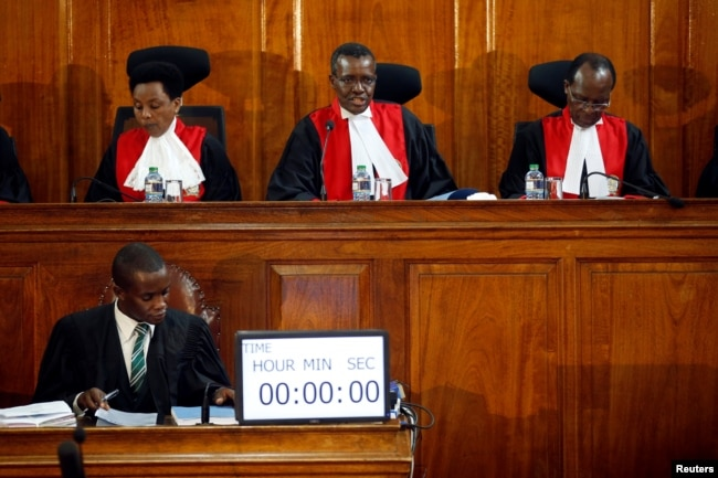 FILE - Kenya's Supreme Court judges attend a hearing regarding petitions challenging the result of the presidential election re-run at Kenya's Supreme Court in Nairobi, Nov. 14, 2017.