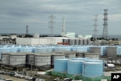 n this Oct. 12, 2017, photo, ever-growing amount of contaminated, treated but still slightly radioactive, water at the wrecked Fukushima Dai-ichi nuclear plant is stored in about 900 huge tanks