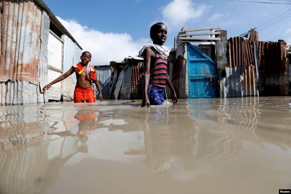 Somali children walk through flood waters after heavy rain in Mogadishu.