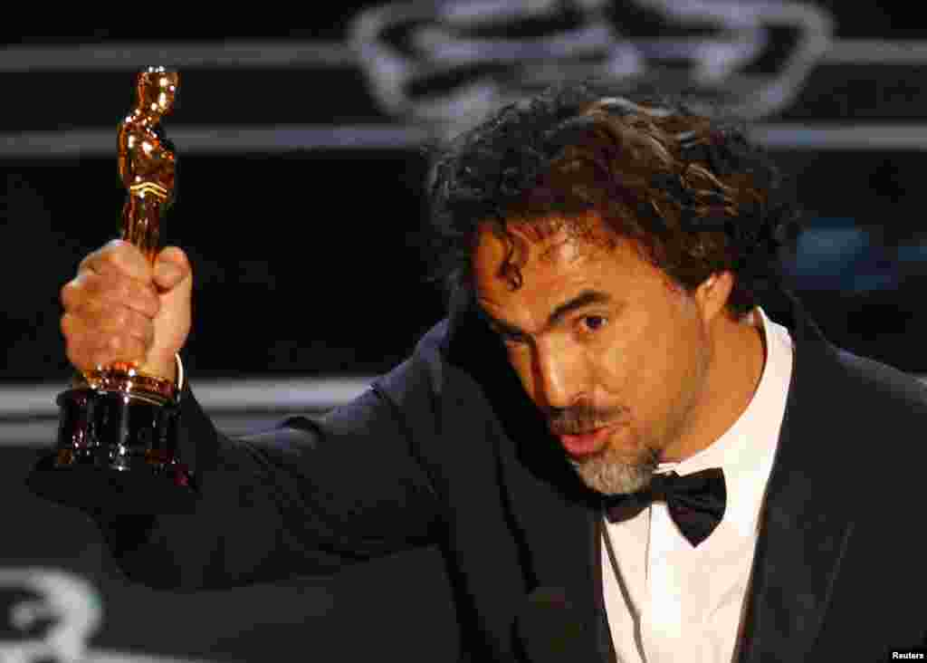 "Director Alejandro Inarritu accepts the Oscar for Best Director for his film ""Birdman"" at the 87th Academy Awards in Hollywood, California, Feb. 22, 2015."