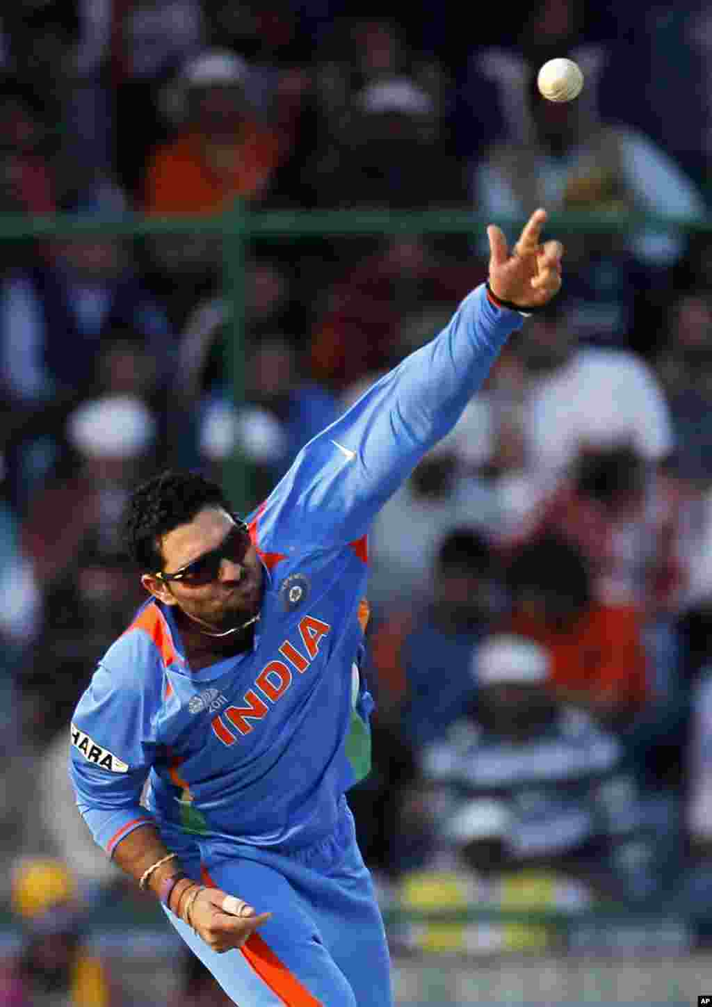 India's Yuvraj Singh dives bowls during their ICC Cricket World Cup group B match against The Netherlands in New Delhi March 9, 2011. REUTERS/Adnan Abidi (INDIA - Tags: SPORT CRICKET)